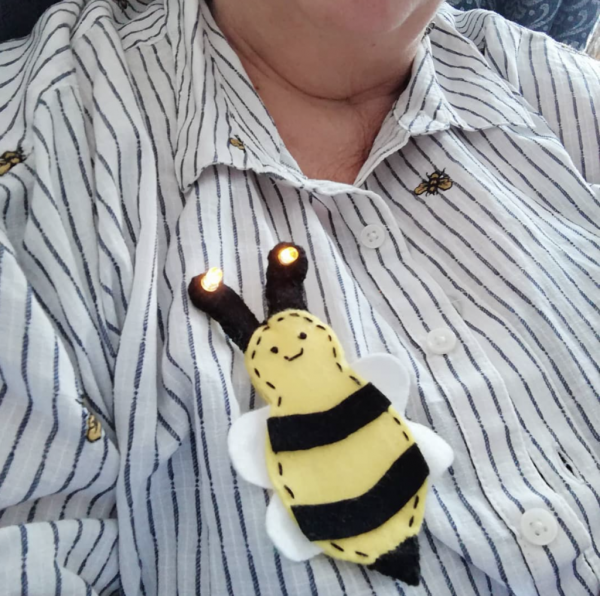 Alyson Hurst wearing her bee brooch